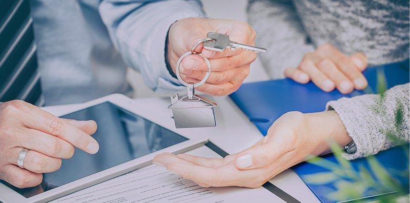 Realtor handing keys to homeowner