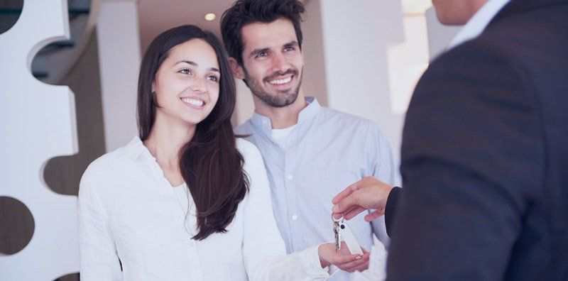 couple talking to mortgage lender