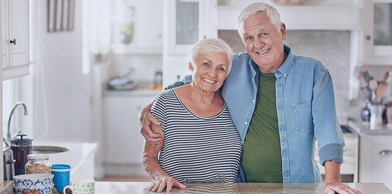 Seniors standing in home