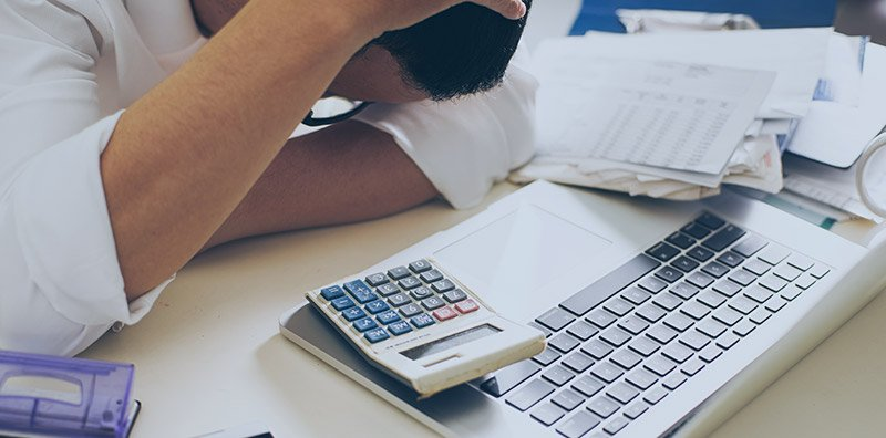 Man calculating debt